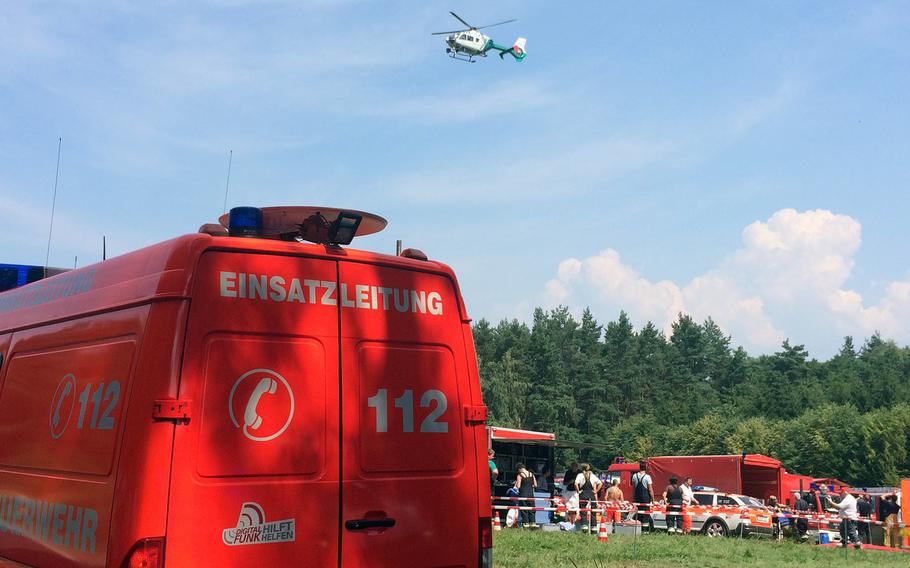Emergency workers respond to the crash of an F-16 figher jet near the city of Bayreuth, Germany, Tuesday, Aug. 11, 2015. The jet, out of Spangdahlem Air Base, Germany, crashed Tuesday morning. A German police spokesman said the pilot ejected safely.