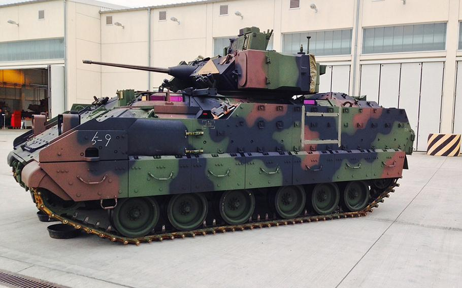 A U.S. Army Bradley Fighting Vehicle painted woodland green sits at Coleman Barracks in Mannheim, Germany, Tuesday, Sept. 1, 2015.