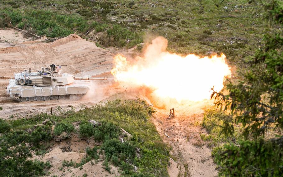An Abrams tank from the U.S. Army's 3rd Infantry Division fires its 120 mm main gun during a live-fire exercise in June 2015 at the Central Training Area near Tapa, Estonia. A 2016 report by Rand Corp. says NATO does not presently have the capability to defend the Baltics if Russia launched an offensive on those allied states.
