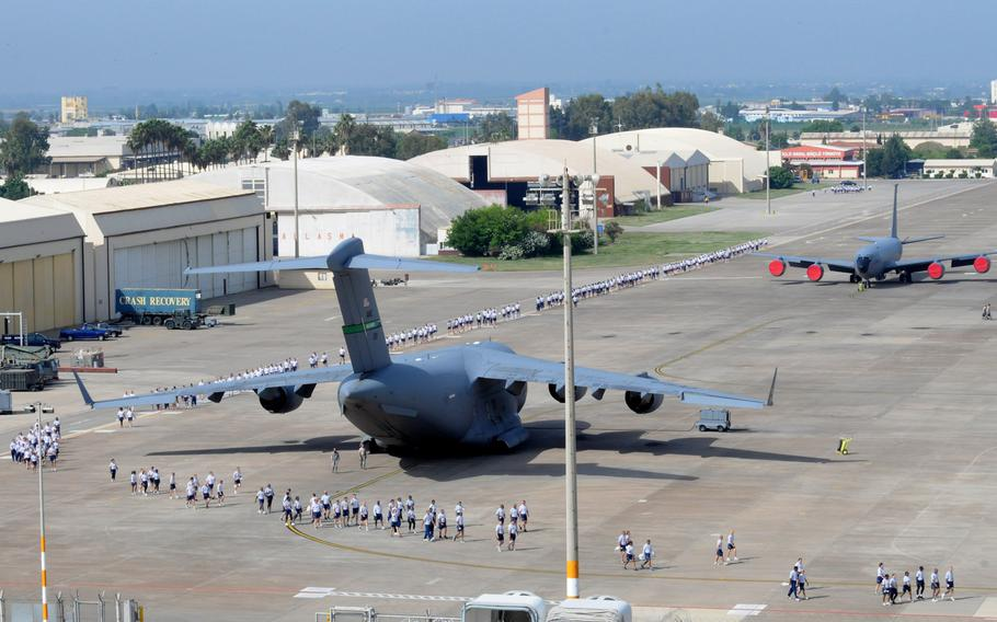 Airmen spread out to begin a foreign-object-debris walk to remove trash and other objects from the flight line at Incirlik Air Base, Turkey, in 2012. The Defense Department has announced on Tuesday, March 29, 2016, that it will start the evacuation all dependents from the base for force-protection reasons.