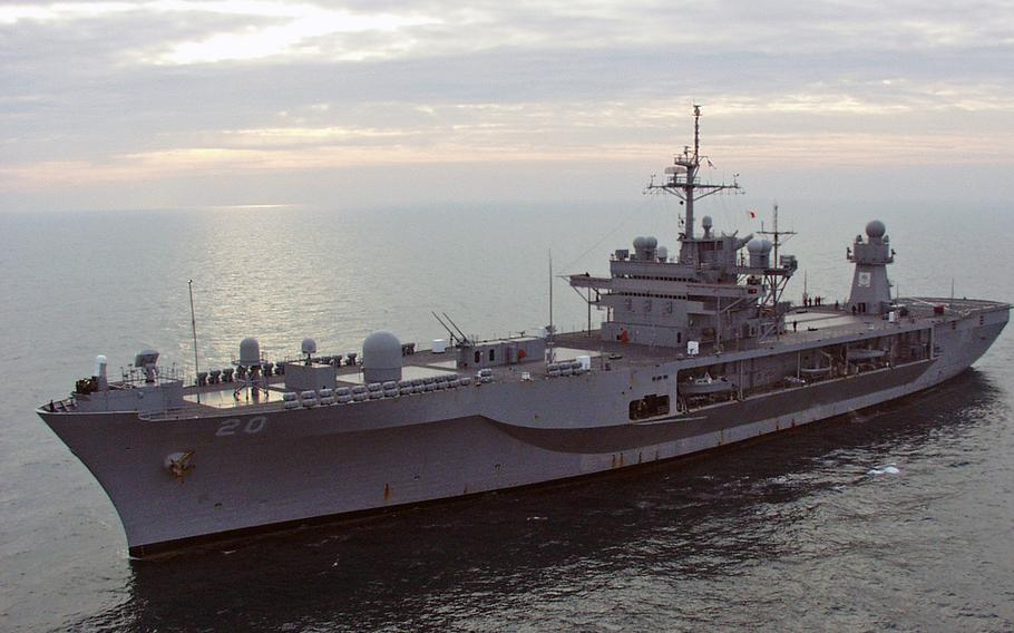 After a 14-day journey across the Atlantic Ocean from Norfolk, Va., the USS Mount Whitney sails toward Gaeta, Italy, just as the sun dawns Tuesday morning, Feb. 1, 2005.