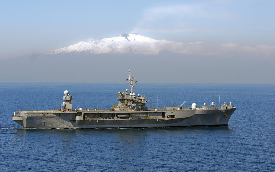 The U.S. 6th Fleet flagship USS Mount Whitney underway past Mount Etna supporting Joint Task Force Odyssey Dawn, March 25, 2011.