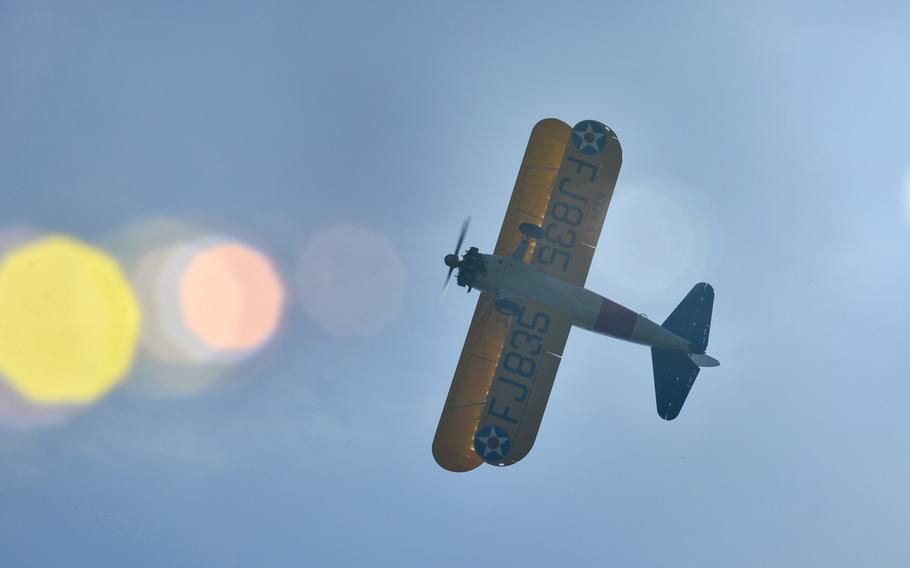A World War I-era Stearman PT-17 biplane flies over the Lafayette Escadrille Memorial in Marnes-la-Coquette, France, April 20, 2016, during a ceremony honoring the 268 Americans who joined the French air force before the U.S. officially engaged in World War I.