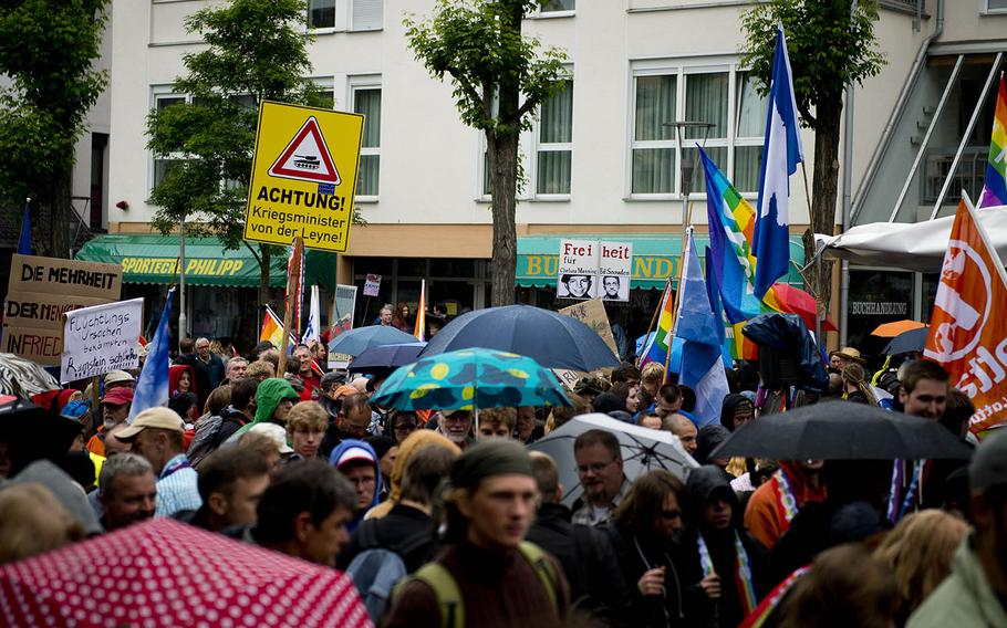 """Several hundred protesters march to form a human chain in Ramstein-Miesenbach, Germany, on Saturday, June 11, 2016. The protest, organized by """"Stopp Ramstein: No Drone War,"""" was aimed against Ramstein Air Base's alleged role in U.S. drone operations."""