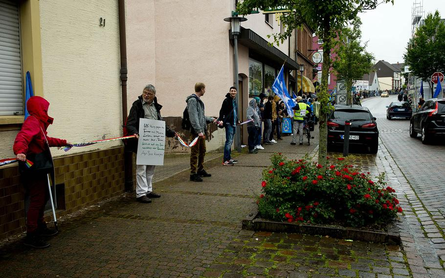 Several hundred demonstrators form a human chain in Ramstein-Miesenbach, Germany, on Saturday, June 11, 2016. They were protesting against Ramstein Air Base's alleged role in U.S. drone operations.