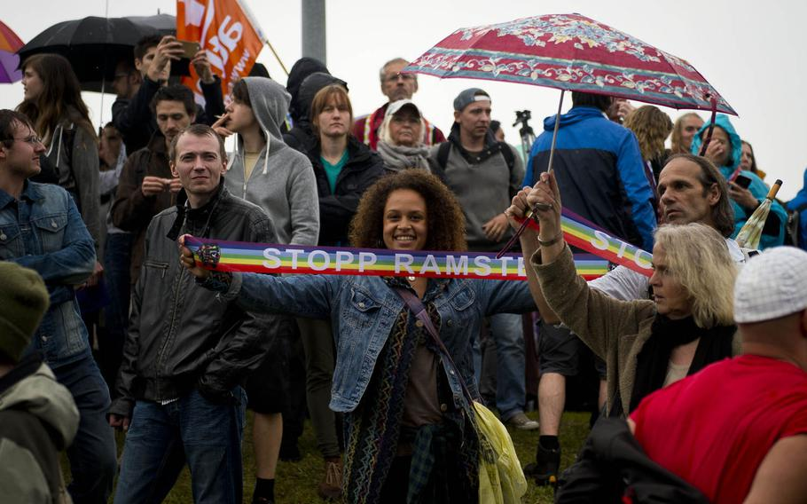 Several thousand protesters gather outside Ramstein Air Base, Germany, on Saturday, June 11, 2016.
