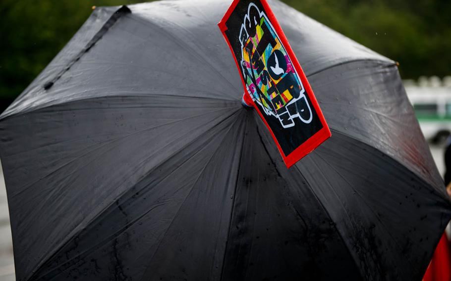 A Stopp Ramstein sign decorates a protester's umbrella outside Ramstein Air Base, Germany, on Saturday, June 11, 2016. The demonstration was held to protest the base's alleged role in U.S. drone operations.