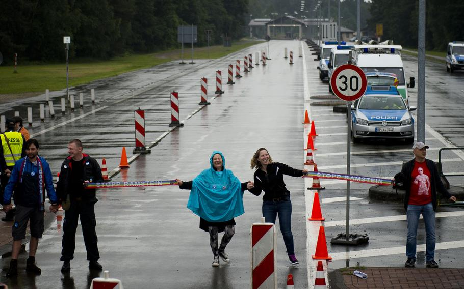 Protesters block traffic going to Ramstein Air Base, Germany, on Saturday, June 11, 2016. The activists were allowed to block traffic leaving and entering Ramstein from the traffic circle for 10 minutes as dozens of policemen looked on.