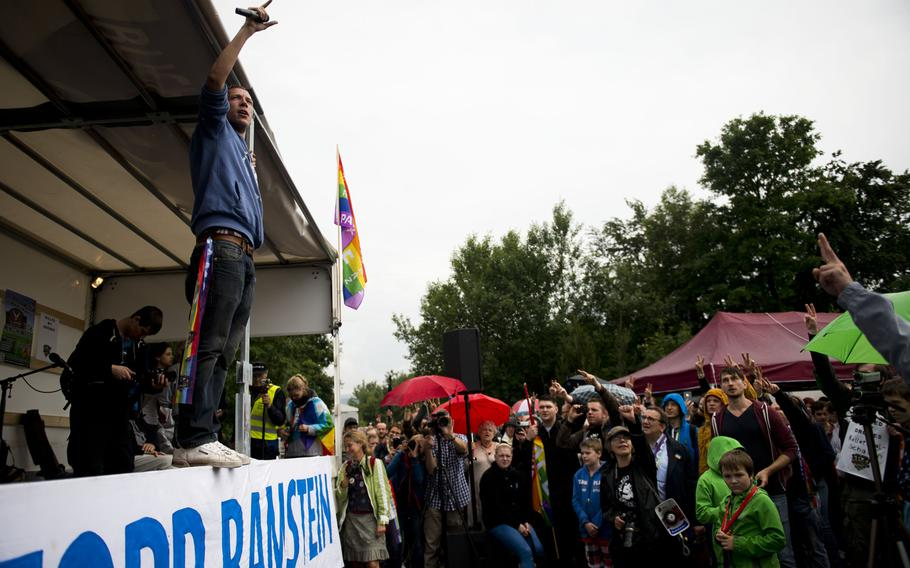 A hip-hop artist performs for several thousand protesters outside Ramstein Air Base, Germany, on Saturday, June 11, 2016.