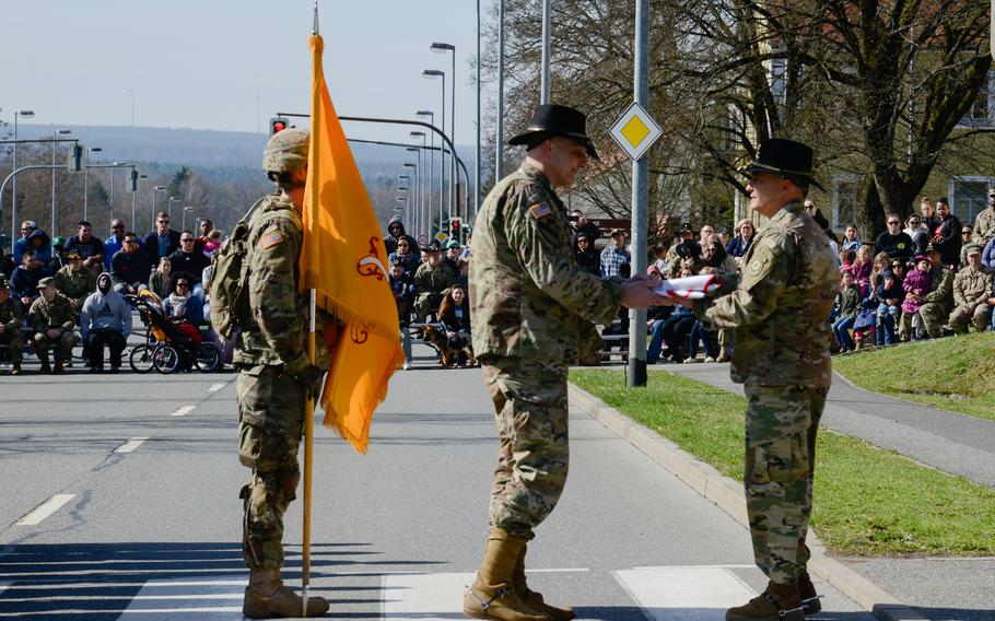 U.S. Army Col. Patrick J. Ellis, right, commander of the 2nd Cavalry Regiment, presents a Regimental Deployment Flag to U.S. Army Lt. Col. Steven Gventer, commander of the 2nd Squadron, 2nd Cavalry Regiment, at the Battle Group Poland Departure Ceremony, March 25, 2017, in Vilseck, Germany.
