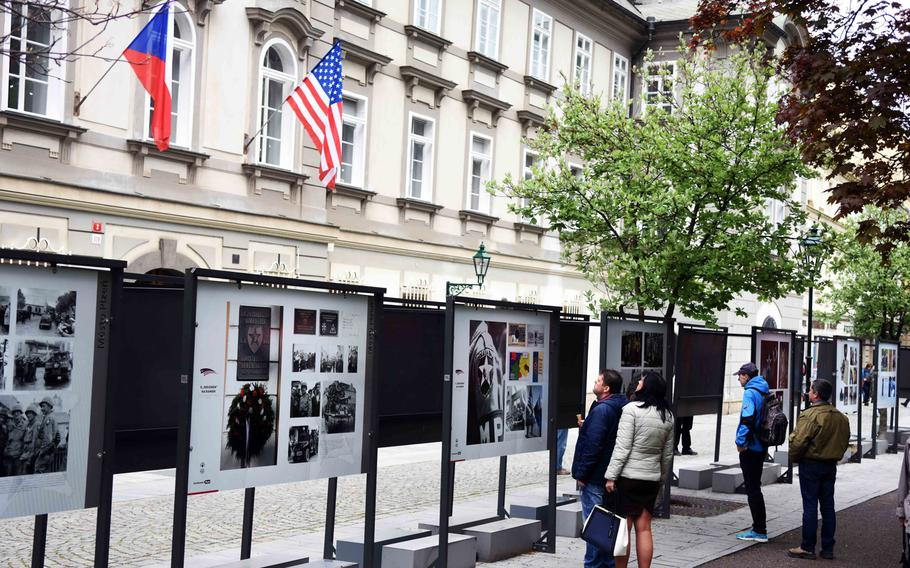 Czech citizens learn about the history of the WWII liberation of Pilsen, Czech Republic, on Friday, May 5, 2017. During the Liberation Festival Pilsen, informative plaques are set up around the city.