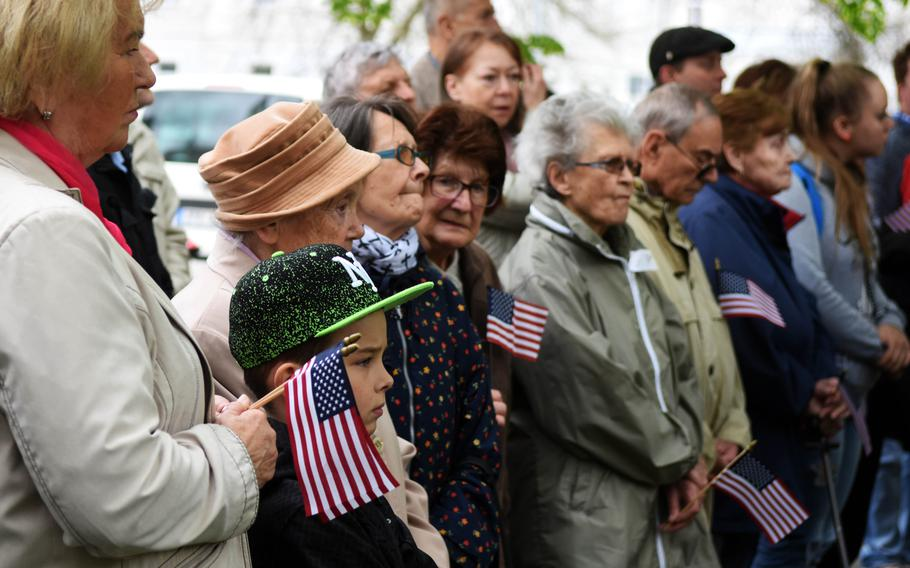 Czech citizens carrying American flags gather to watch a memorial to American soldiers, during the Liberation Festival Pilsen, Friday, May 5, 2017.