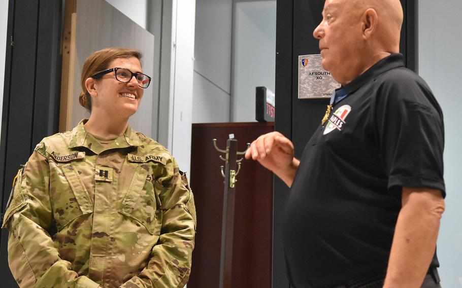 Medal of Honor recipient Gary Littrell talks with Capt. Allison Anderson on May 12, 2017, during a tour of the NATO Allied Joint Force Command in Lago Padria, Italy.