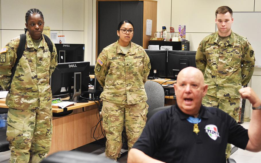 Soldiers give Medal of Honor recipient Gary Littrell rapt attention during his May 15, 2017, visit to the NATO Allied Joint Force Command in Lago Padria, Italy.