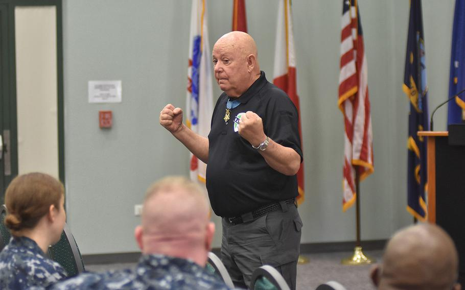 Medal of Honor recipient Gary Littrell talks to sailors at the Navy base in Naples, Italy, on May 12, 2017.