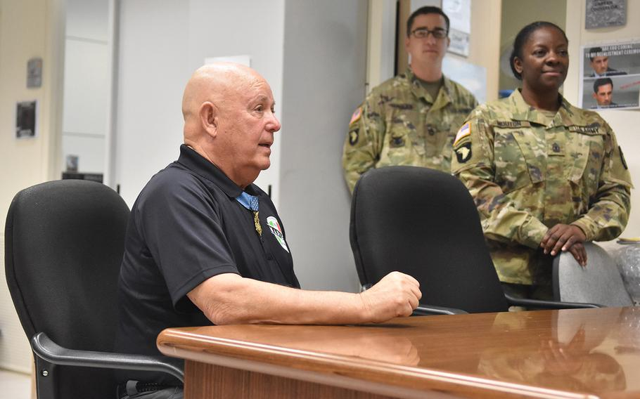 Medal of Honor recipient Gary Littrell talks to soldiers at NATO Allied Joint Force Command in Lago Padria, Italy, on May 12, 2017.