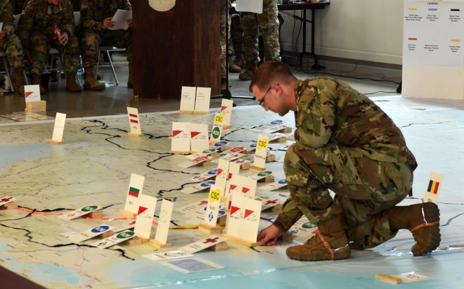 A U.S. soldier moves markers representing soldiers of U.S., allied and partner nations along their intended route to the Black Sea during the rehearsal of concepts drill for Exercise Saber Guardian at Vilseck Germany, Friday, June 9, 2017.