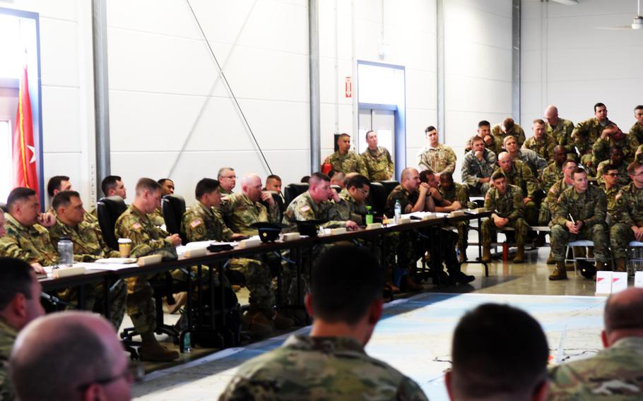 The command element of the U.S. 2nd Cavalry Regiment, leaders of the 7th Army Training Command and representatives from allied and partner nations discuss the upcoming Exercise Saber Guardian at the rehearsal of concept drill at Vilseck, Germany, Friday, June 9, 2017.