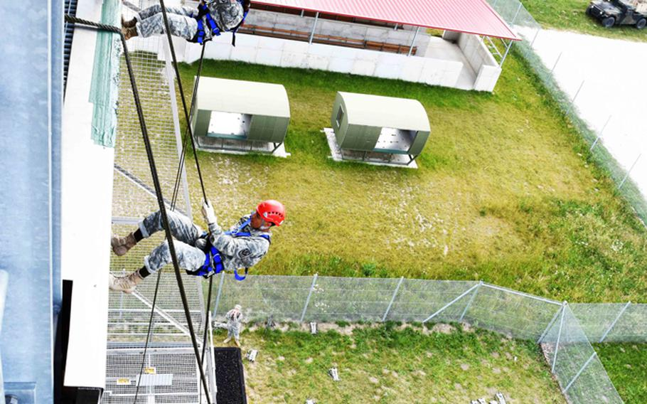 JROTC cadets from across Europe rappel down a tower Wednesday, June 21, 2017, at Grafenwoehr, Germany.