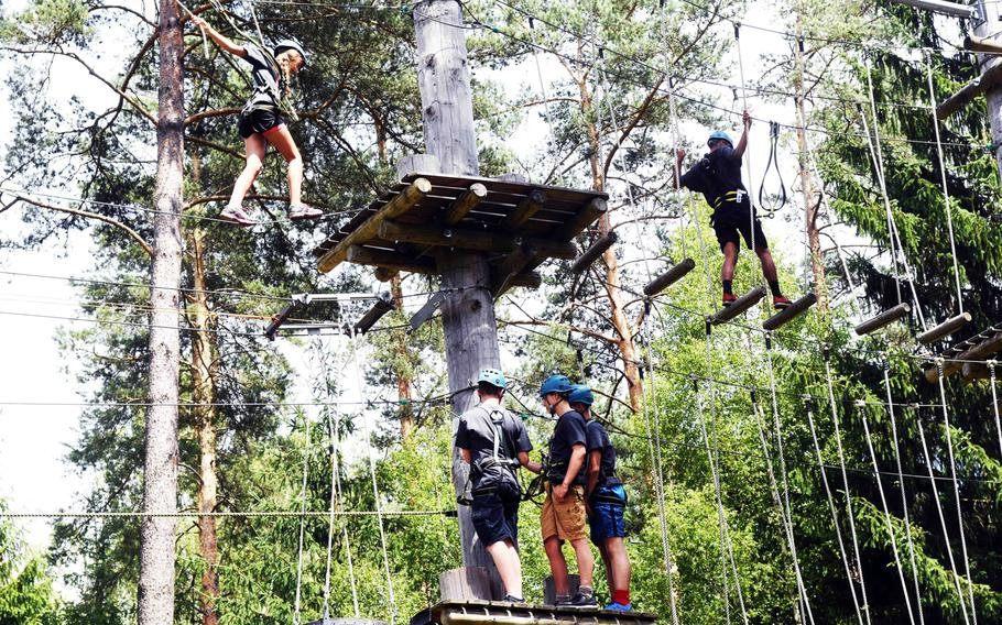 JROTC cadets climb through the high-ropes course at Grafenwoehr, Germany, Friday, June 23, 2017.