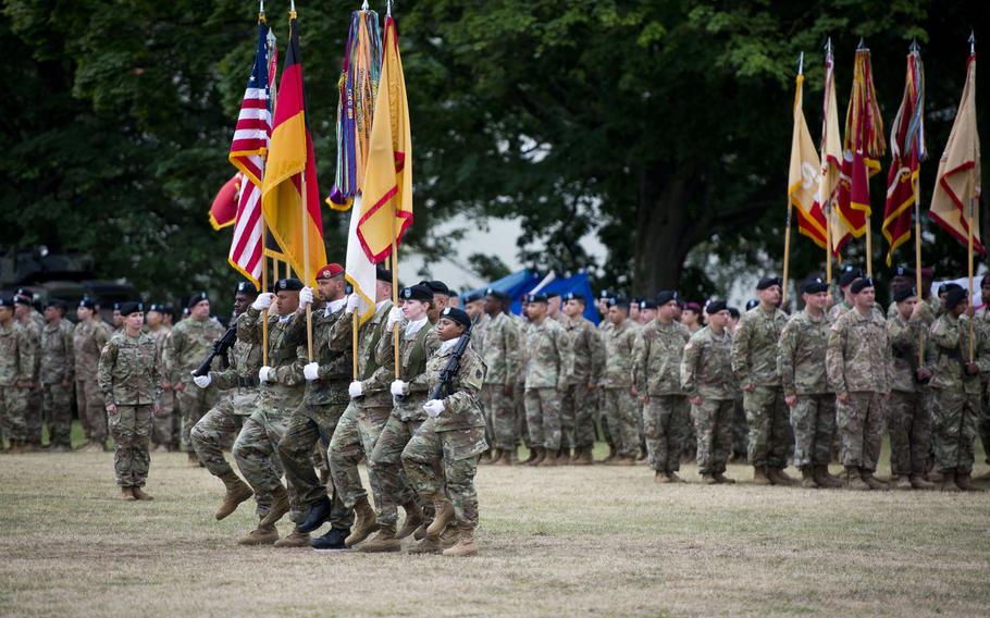 The color guard marches during the 21st Theater Sustainment Command change-of-command ceremony at Daenner Kaserne, Germany, on Friday, June 30, 2017.