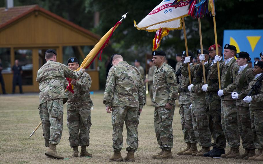 U.S. Army Europe commander Lt. Gen. Ben Hodges, left, passes the 21st Theater Sustainment Command's colors to Maj. Gen. Steven Shapiro during the TSC's change-of-command ceremony at Daenner Kaserne, Germany, on Friday, June 30, 2017.