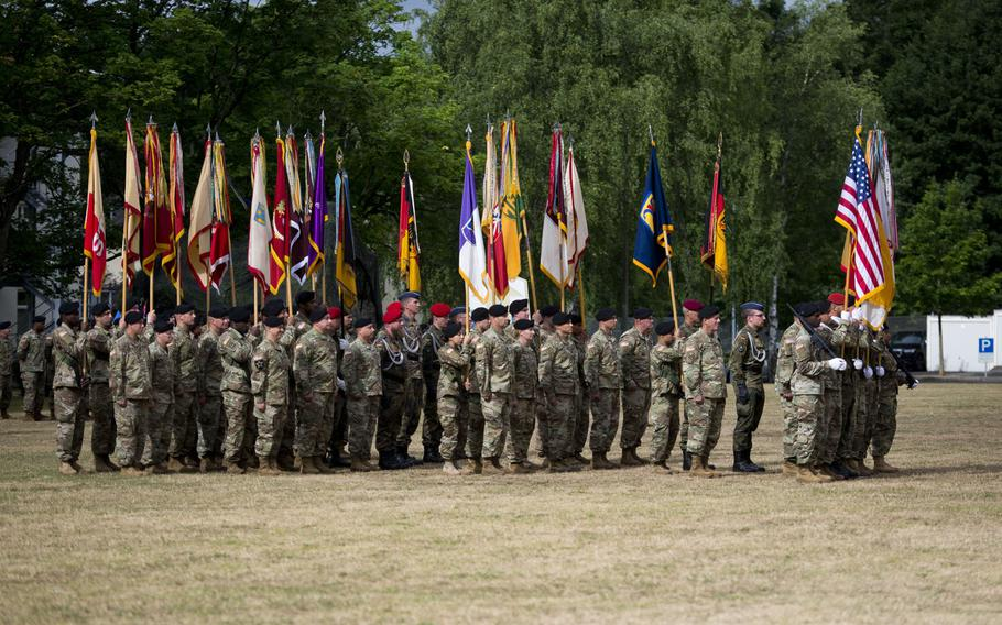 National and Army flags and colors of various units of the 21st Theater Sustainment Command are displayed in formation during the TSC's change-of-command ceremony at Daenner Kaserne, Germany, on Friday, June 30, 2017.
