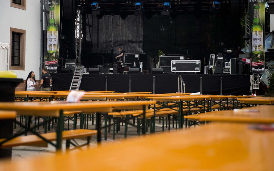 A sound technician sets up a stage for the annual Lautrer Altstadtfest in Kaiserslautern, Germany, on Friday, June 30, 2017. The festival features shopping, food and live music.