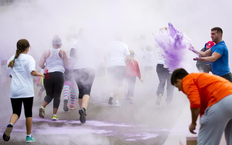 Participants run through the first color station during the Color Run at Ramstein Air Base, Germany, on Saturday, Aug. 12, 2017.