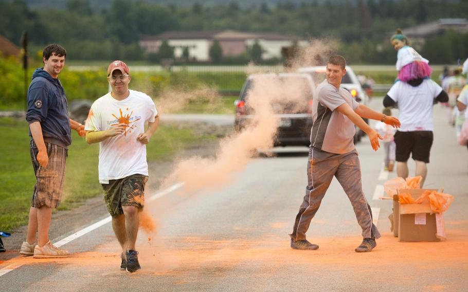 A runner almost gets through a color station unscathed during the Color Run at Ramstein Air Base, Germany, on Saturday, Aug. 12, 2017.