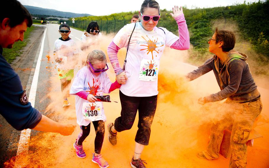 Participants run through colored powder during the Color Run at Ramstein Air Base, Germany, on Saturday, Aug. 12, 2017.