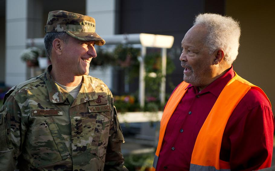 Air Force Chief of Staff Gen. David Goldfein, left, and Charlie Searchwell joke together at Ramstein Air Base, Germany, on Monday, Aug. 21, 2017.