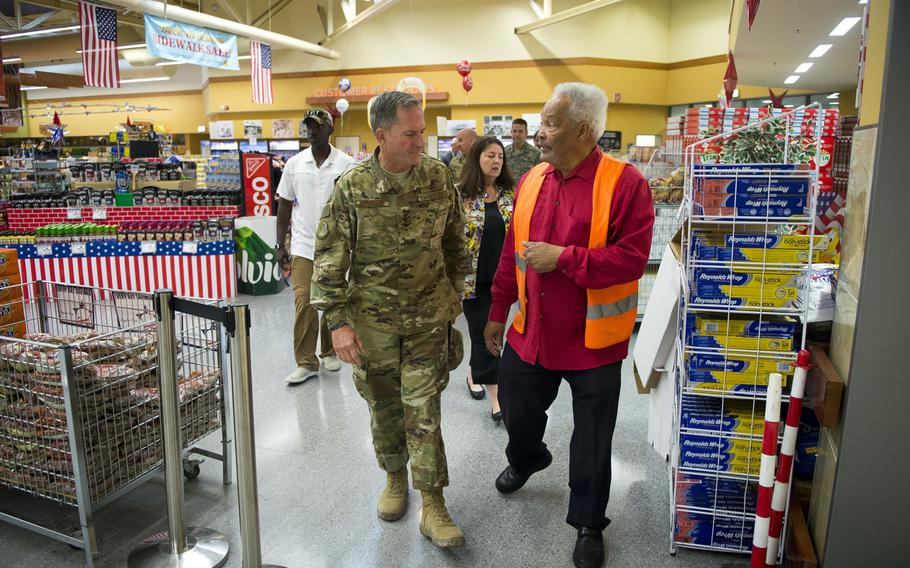 Air Force Chief of Staff Gen. David Goldfein, left, and Charlie Searchwell walk through the commissary at Ramstein Air Base, Germany, on Monday, Aug. 21, 2017.