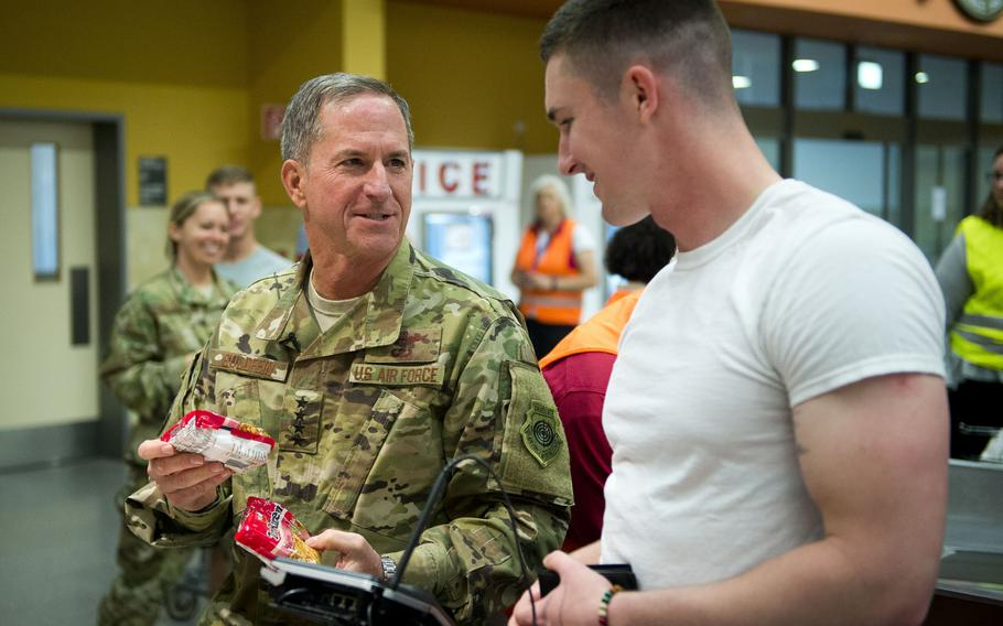 Air Force Chief of Staff Gen. David Goldfein, left, jokes with Pfc. Mitchell Trotter's grocery selection at Ramstein Air Base, Germany, on Monday, Aug. 21, 2017. Mitchell works in preventive medicine at the Landstuhl Regional Medical Center.