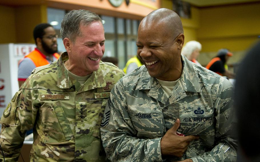 Air Force Chief of Staff Gen. David Goldfein, left, and Chief Master Sgt. Jackie Harris, 24th Intelligence Squadron superintendent, share a laugh at Ramstein Air Base, Germany, on Monday, Aug. 21, 2017.