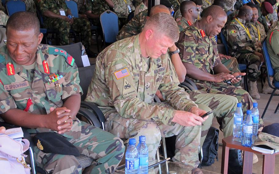 Maj. Gen. Joseph Harrington, commander of U.S. Army Africa, center, at a peacekeeping demonstration at the African Land Forces Summit in Lilongwe, Malawi, on May 9, 2017. Harrington was suspended Friday pending an investigation into flirtatious text messages he is suspected of sending to another man's wife.