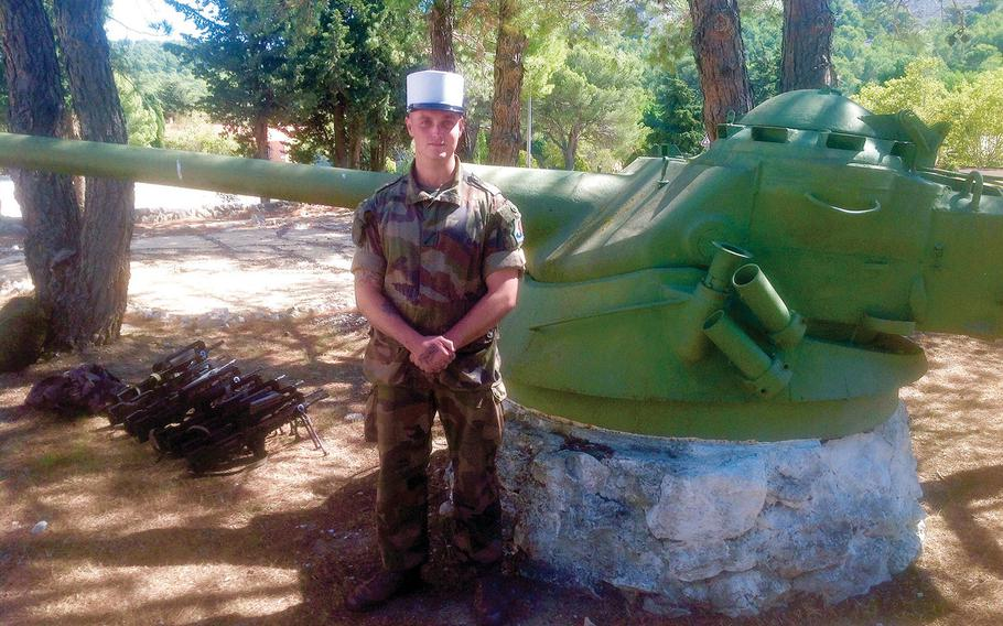 Edward, an American member of the French Foreign Legion, takes a break during a weapons drill in September at Camp de Carpiagne, home base of the Legion's First Cavalry Regiment. The 24-year-old former U.S. Marine was given a new identity upon joining the Legion. He now operates a Milan anti-tank missile.
