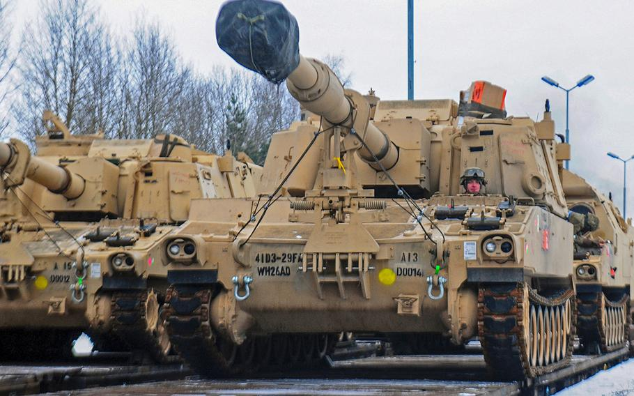 A U.S. soldier from 3rd Battalion, 29th Field Artillery Regiment, 3rd Armored Brigade Combat Team, 4th Infantry Division, drives an M109 Paladin self-propelled howitzer off of a flatcar in Drawsko Pomorskie, Poland, on Jan. 9, 2017. Police in Germany on Thursday, Jan. 11, 2018, halted the shipment of six U.S. Army M109 howitzers because they lacked the proper paper work.