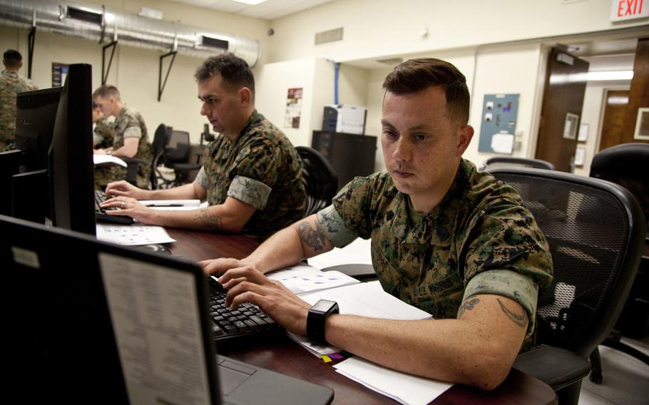 U.S. Marines work on an assignment during the Cyber Security Technician course at Marine Corps Base Twentynine Palms, Calif., in 2017. A data breach coming from the Marine Corps Forces Reserve on Feb. 26, 2018, affected the personal information about 21,000 people, service officials said.