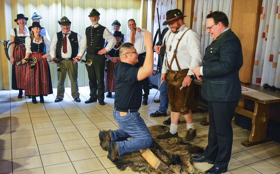 U.S. servicemembers and base workers are knighted into a German hunting order in Ansbach, Germany, on Jan. 26, 2018.