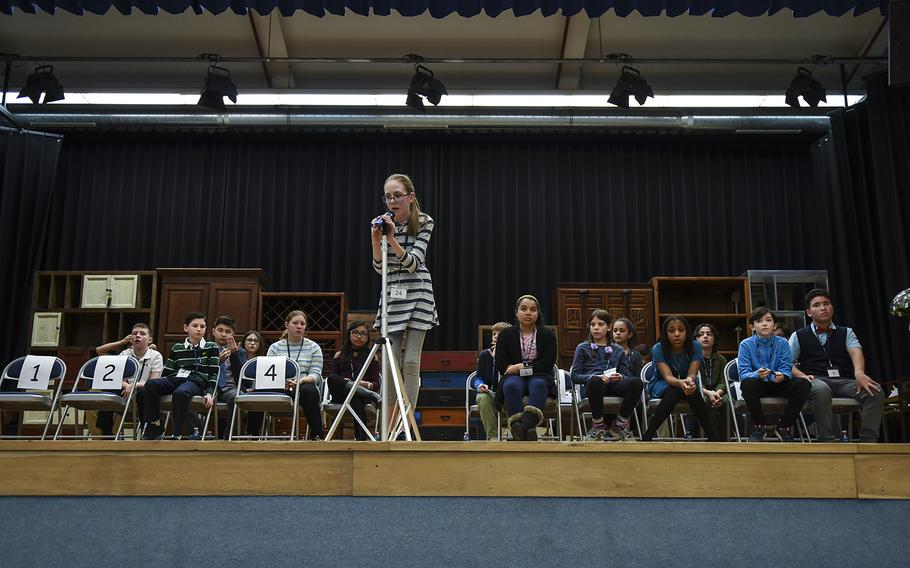 Asenath Wetzel of Vicenza Middle School, Italy, spells a word during the early rounds of the 35th Annual European PTA Spelling Bee on Saturday, March 10, 2018. Twenty-seven students from DODEA schools in Europe participated. The contest was held at Ramstein Elementary School in Germany.