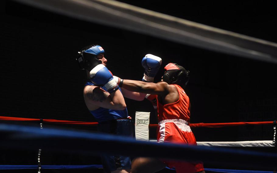 Calvin Collins, fighting out of Grafenwoehr, lands a jab on Vilseck's Jonathon Martinez, during the U.S. Army Garrison Bavaria St. Patrick's Day Boxing Invitational, Saturday, March 17, 2018, at Vilseck, Germany.