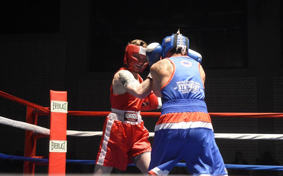 Vilseck's Bradon Petrig lands a punch on Stuttgart's Simon Martinez, during the U.S. Army Garrison Bavaria St. Patrick's Day Boxing Invitational, Saturday, March 17, 2018, at Vilseck, Germany.