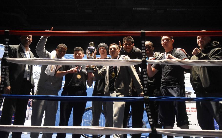 Boxers with the Vilseck team hold up their first place trophy at the U.S. Army Garrison Bavaria St. Patrick's Day Boxing Invitational, Saturday, March 17, 2018, at Vilseck, Germany. Organizers later figured out that the points had been tallied incorrectly and Stuttgart was the winner.