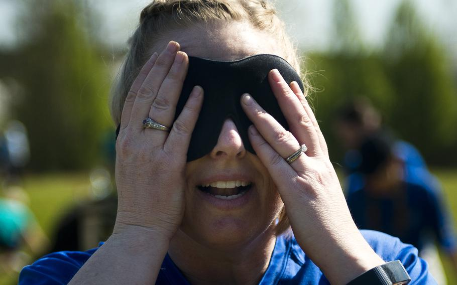 U.S. Air Force Senior Master Sgt. Bridgett Manning wears a blindfold during a Courage, Leadership, Education, Advocacy and Respect Challenge obstacle at Ramstein Air Base, Germany, on Friday, April 20, 2018. Manning is a member of When Doves Fly, a 76th Airlift Squadron Team.