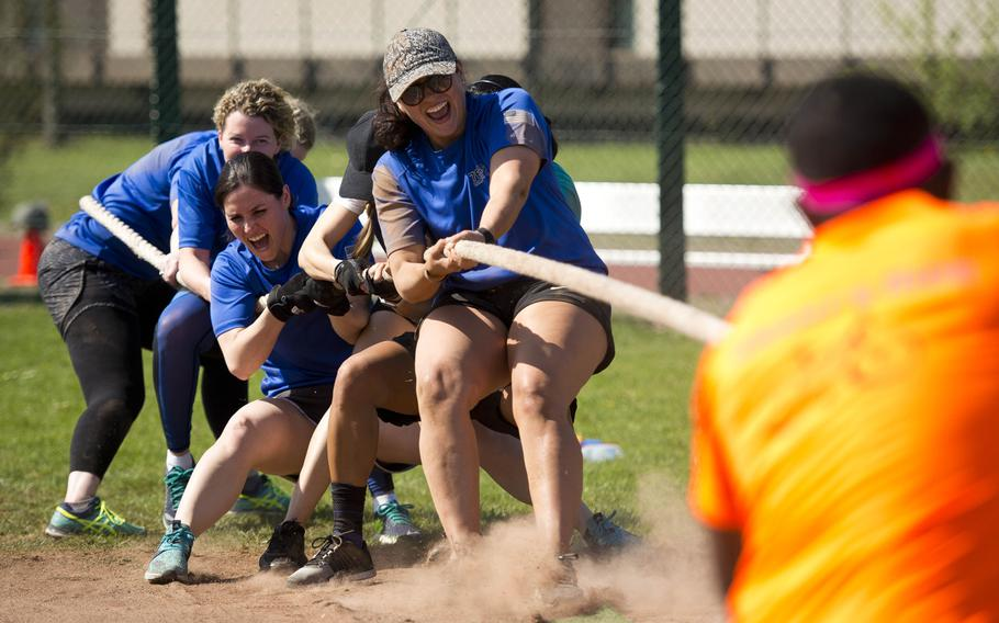 When Doves Fly, a 76th Airlift Squadron team, battles a fellow squadron team, Not Our First Rodeo, during a tug-of-war match at Ramstein Air Base, Germany, on Friday, April 20, 2018.