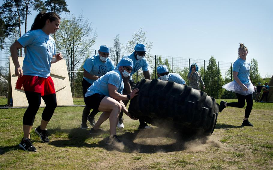 A team from the 86th Dental Squadron flips a tire during the annual Courage, Leadership, Education, Advocacy and Respect Challenge at Ramstein Air Base, Germany, on Friday, April 20, 2018.