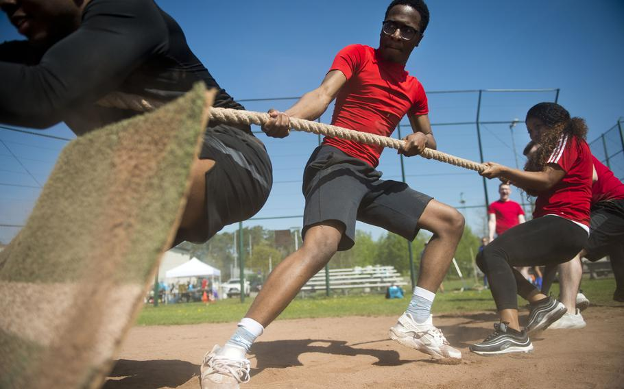 The Super Saiyans, an 86th Comptroller Squadron team, competes in a tug-of-war match at Ramstein Air Base, Germany, on Friday, April 20, 2018.