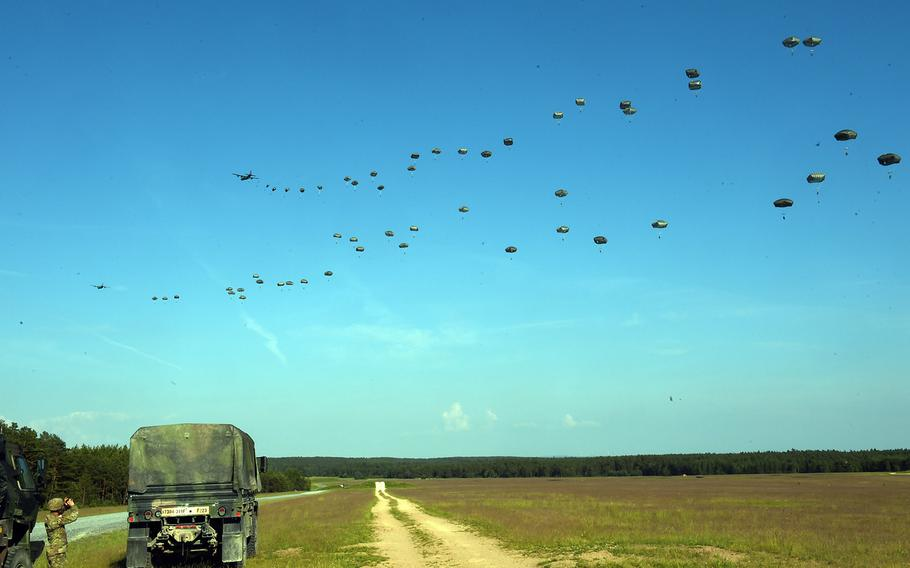 Paratroopers with the 173rd Brigade Combat Team (Airborne) jump out of a C-130 Hercules and drop to an artillery live-fire exercise at Grafenwoehr, Germany, Friday, May 18, 2018.