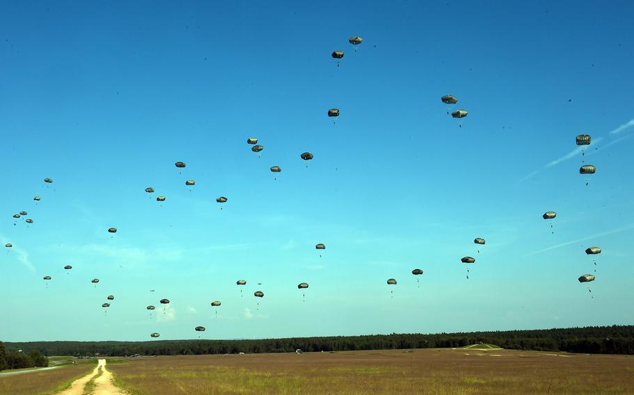 Paratroopers with the 173rd Brigade Combat Team (Airborne) drop down to an artillery live-fire exercise at Grafenwoehr, Germany, Friday, May 18, 2018.